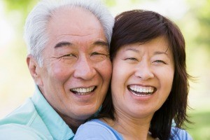 Older Asian man and woman smiling and laughing