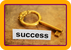 Gold key with round fob and the word success underneath